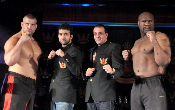 from left : Super Heavy Weight Fighter, James Thomson, Raj Kundra, founder of Super Fight Promotions Pvt.Ltd. Company with Indian Bollywood Actor Sanjay Dutt, co-founder and Chairman, Super Heavy Weight Fighter Bob Sapp pose during the launching of India?s first professionally organized mixed martial art (MMA) fighting league, Super Fight League ?SFL?  in Mumbai on January 16, 2012.  AFP PHOTO/Sujit Jaiswal. (Photo credit should read STRDEL/AFP/Getty Images)