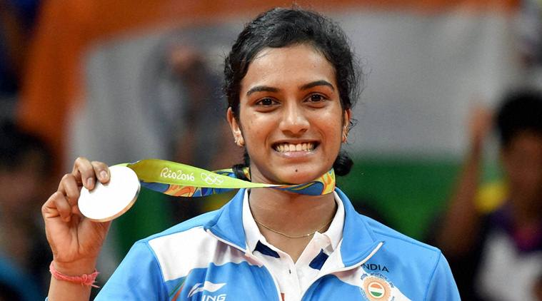 Rio de Janeiro: India's Pusarla V Sindhu poses with her silver medal after her match with Spain's Carolina Marin in women's Singles final at the 2016 Summer Olympics at Rio de Janeiro in Brazil on Friday. PTI Photo by Atul Yadav    (PTI8_19_2016_000286b)